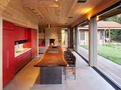 red & a piece of nature's art in your kitchen - the seats R comfortable - Aptos Retreat by CCS Architecture