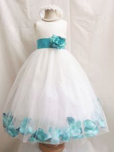 BEAUTIFUL ROSE PETALS WEDDING FLOWER GIRL PARTY DRESS. The middle back of the skirt has a little opening to remove the rose petal. The waistline is decorated with removable color sash and flower of your choice.   eBay!