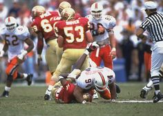 Miami Hurricanes defensive tackle Dwayne Johnson knocks Florida State quarterback Charlie Ward to the ground in 1993.