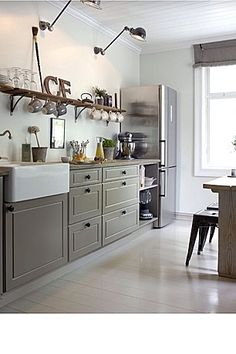 Grey base cabinets with great wood floating shelf