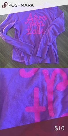 Aeropostale long sleeve T shirt I'm like new condition no pilling or stains.   Very comfortable.  Lilac shirt with pink writing.  Rounded neck. Aeropostale Tops Tees - Long Sleeve
