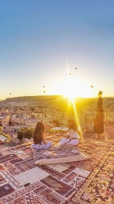 Cappadocia, Turkey. A stunning sunrise with hundreds of hot air balloons in Goreme / Göreme in Cappadocia. Cappadocia has weird formations, fairy chimneys, caves, underground city.. and is the most magical place on earth