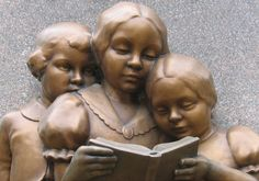 Sculpture of three children reading located on the base of the William Holmes McGuffey memorial in Oxford, Ohio.  -  Photograph by Dr. Roy Winkleman
