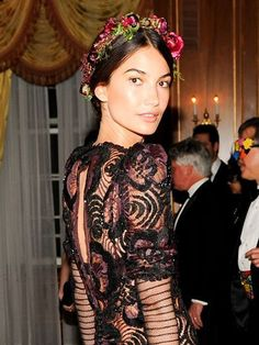 Lily Aldridge's bronze makeup and updo with a flower crown | allure.com