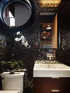 Powder room. modern powder room. Not my usual, traditional taste but I'm digging the mosaic tile