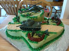 Army Cake - Army theme cake for a 7 yr old who loves anything Army.  Chocolate cake, buttercream frosting.  Toys used for decorations, so he would have something to keep after the cake was gone.  He loved it!  Thanks for looking!