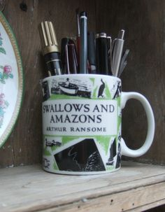 The cover of the Jonathan Cape edition of 'Swallows and Amazons' by Arthur Ransome depicted on a mug.