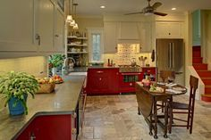 A beautiful vintage L-shaped kitchen with eclectic design features white & red cabinets against a beige wall accent. Beige Kitchen, Kitchen And Bath Design, Red Kitchen, Kitchen Redo, Kitchen Colors, Kitchen Remodel, Kitchen Ideas, Country Kitchen, Vintage Kitchen