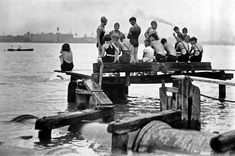 Detroit River swimmers, 1930s (http://windsorthenwindsornow.wordpress.com/2011/02/25/the-good-old-days-swimming-in-the-poopy-detroit-river/)