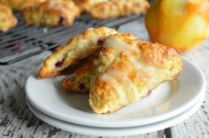 Cranberry Orange Scones are fluffy, buttery scones that will melt in your mouth. Tart and sweet, you'll be entralled.