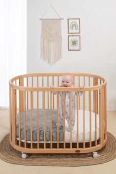 Transform your nursery into an oasis of calm with our innovative new oval cot. Pushing the boundaries of traditional cot design, the Oasis Oval Cot is expertly crafted from sustainable solid wood into a beautifully soft rounded shape.  Dainty spindles coupled with the unique shape offer optimum visibility, especially when placed in the parents bedroom, making the Oasis Oval Cot an ideal alternative to traditional bedside sleepers during those early stages. Safari Nursery, Woodland Nursery, Bedside Sleeper, Cosy Sofa, Bohemian Nursery, Baby Bunting, Baby Room Design, Cot Bedding, Nursery Inspiration