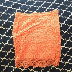 Gorgeous orange lace skirt Condition as show. This item is in good condition but it has been worn please ask any questions before purchasing. This item will only be traded for an autographed Authentic Chanel original, a Lamborghini, a penthouse in Paris, or the services of an Audi mechanic. All orders will be recorded before shipping. I do not model. Please see my reasonable offer chart before submitting an offer. Jack by BB Dakota Skirts