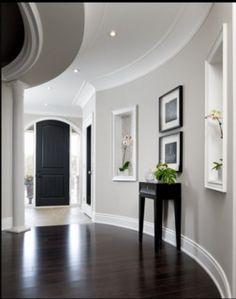 Dark espresso floors and doors, gray walls, white trim
