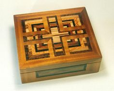 Wooden Box: The woods are: benin, tropical olive, lacewood, Indian rosewood, sweet gumwood, African cherry, and macassar ebony.