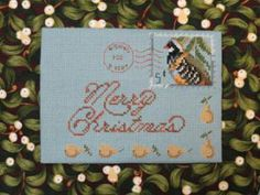 """""""A Partridge Christmas"""" is the title of this cross stitch pattern from Lynne Nicoletti that features a Christmas postcard design with a part..."""