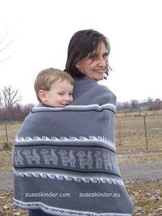 baby wearing poncho