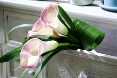 Bridesmaid Bouquet with pink callas and lily grass