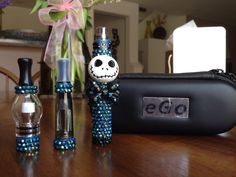 Since my Jack Skellington Themed Vape is one of my most popular , I decided to make another in Blue . 1100mah Battery Vaporizer , Black Ce4 Clearomizer , Glass Globe Dry Herb/Wax/Oil Atomizer , Empty Needle Point E-Juice Bottle , USB Charger & Matching Black Travel Case . Vaporizer+jack+skellington, bling+vape, bling+vaporizer, jack+skellington+vaporizer, jack+skellington