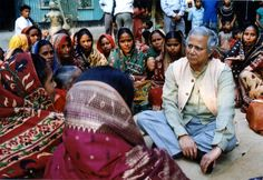 The creator of microfinance, Muhammad Yunus, sits and listen to a group of women interested in receiving micro loans to help them off their feet. (Source: Grameen Bank)