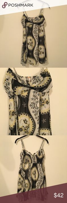 FREE PEOPLE Floral Printed Sleeveless Dress Free People yellow and cream with black accents - floral print and is sleeveless. Size medium! In good condition! Free People Dresses Midi