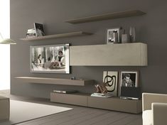 sectional wall mounted tv wall system inclinart 265 by presotto design pierangelo sciuto
