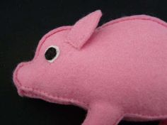 Peter the Pig is lovingly handmade. He is crafted from pink felt, has felt eyes and a little piggy tail. Peter measures 13cm x 9cm and is an original design from my late mother after she first made him in the 1960s.  There are two pigs in stock and as all of Missys Matters items are handmade there will be slight variances between them. This makes all pigs unique just as they would be in the real life.  By purchasing toys from Missys Matters you are helping support our environment and animals…