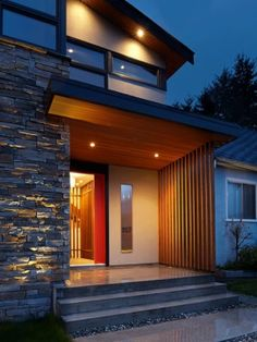 #contemporary LOVE the cedar trim at the bottom of the overhang...with down lights!