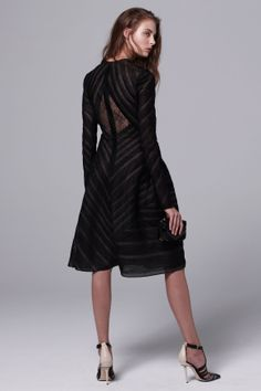J. Mendel - Black striped lace crew-neck long-sleeve asymmetrical full-skirted dress with picot stitch detailing and crystal bijoux embroidery. Black python, pony, lizard and spazzolato striped patchwork Mini minaudiere.