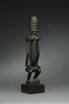 AN UNUSUAL DOGON FIGURE height 9 ¾in