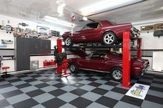 A hot rod lover's dream, this garage by Zillow Digs Designer Remodeling GuysfeaturesViking flooring and a custom organization system on the walls to keep everything sleek and tidy.