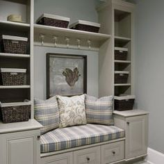 Utility room - good oragnization for a smaller area.  Has shelves, cabinets, hooks, etc.  Probably would use picture or pillows, maybe cushion, but make the seated area a lift up chest to hold stuff (instead of drawers)