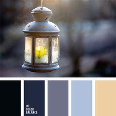 Die Kombination von den pastellen Grau-Hellblautönen und der Farbe der Kerzenflamme werden durchdie blau-schwarze Farbe des Krähenflügels hervorgehoben. D.