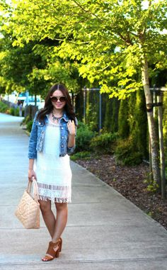 Spring Breeze Outfit Post: White fringe dress, distressed denim jacket, beige pumps, Chanel Medallion Tote, statement necklace and retro shades.   Full outfit details on www.andshedressed.com