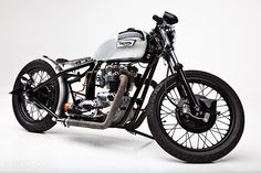One of the sexiest looking Triumph bobbers I've seen. I think its a good nod to the cafe racer but still something totally different.