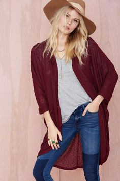Layer it on with this perfect long oxblood knit cardi featuring a drapey open front and rolled dolman sleeves.
