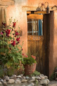 Santa Fe style -hollyhocks and old doors and adobes made of terracotta clay Más Cool Doors, Unique Doors, Entrance Doors, Doorway, Santa Fe Style, Land Of Enchantment, Rustic Doors, Hollyhock, Southwest Style