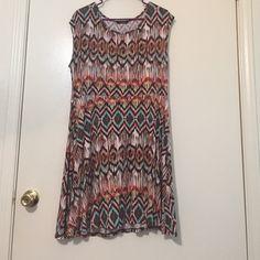 Aztec Print Dress Aztec Printed dress. Small bit of a cap sleeve. I'm 5'6 and this hits above my knee. Deb Dresses Mini