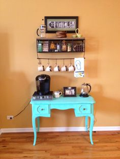 """Update (we moved!): http://www.pinterest.com/pin/144115256801656397/  Our new coffee bar! My great aunt left me a vanity I used to play with when I was little and I've been dying to do something fun with it. Thanks to my awesome husband for repainting the piece - you know, after having a lesson on the meaning of """"shabby chic"""" :) Must give credit to this blogger who inspired the idea. http://ournavylife.blogspot.com/2012/07/diy-coffee-bar.html?m=1"""