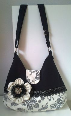 Hobo style bag. Beautiful and feminine with lace and flower embellishments.