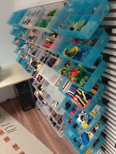 IKEA Hackers: Use MANDAL to store your LEGO bricks for quick & easy building Use a slatted Ikea headboard as a home slatwall, and use binder clips to attach the boxes (the binder-clip wings slip into the hinge clips for these boxes; their hinged lids have been removed)