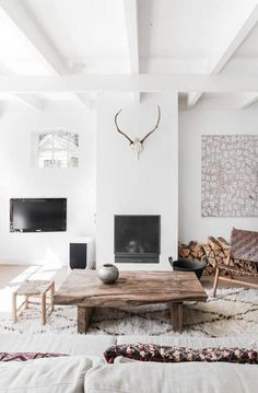rustic interiors white living room with antlers above fireplace
