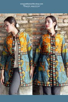 Batik Amarillis' s Ildiko Jacket no 2 This well-tailored stunning elegant long jacket will add statement appeal to your outwear collection.features handmade chinese frog buttons,contrastinng waistband,hemline,sleeveline etc each details meaning to create a standout piece that  will enliven your look.