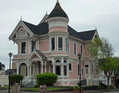 """This ornate Queen Anne Victorian at 2nd and M Streets, Eureka, California was built as a wedding gift for J. Milton Carson by his father William Carson. Locally known as """"the Pink Lady"""" it is across the street from the Carson Mansion."""
