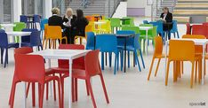 Pop red, blue, green and orange school canteen chairs.