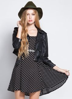 """Unbearably cute polka dot day dress. Back crossover straps and zip back closure.   100% Rayon  Length: 30"""""""