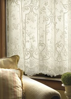 Ivy leaves and vines cascade through ornate grillwork and garden gates edged in lace. Shop at heritagelace.com. #panel #curtains