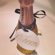 Mini champagne bottles covered in glitter...yes please!! Use as a favor or toast.  www.thefinaltouchevents.com
