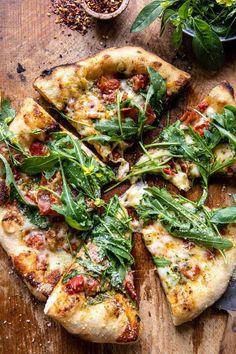 Arugula Tomato Cheese Pizza | halfbakedharvest.com Cherry Tomato Sauce, Roasted Cherry Tomatoes, Pizza Recipes, Dinner Recipes, Dinner Ideas, Meal Ideas, Cheesy Recipes, Veggie Recipes, Food Ideas