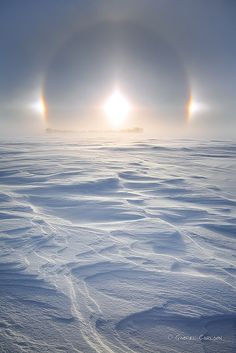 Sun Dog 2013 Sun Dogs ~ are made of a large family of halos, created by light interacting with ice crystals in the atmosphere. Sun Dogs are best seen and most conspicuous when the Sun is close to the horizon.