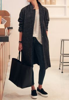 *black slip on sneakers, black jeans, torn white tee, heathered wool coat